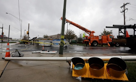 Crews work to fix damage in Philadelphia after the storm.