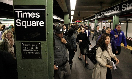 Passengers exit a train in New York's Times Square station. The Army Corps of Engineers removed water in several stations, allowing some public transit to resume.