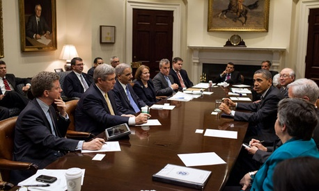 Obama drops in on a cabinet meeting in April.