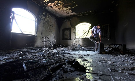 A Libyan man investigates the U.S. Consulate in Benghazi after it was attacked last month.
