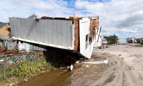 Part of a home rests upside-down in Seaside Heights, N.J. after the storm.