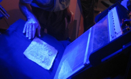 Sinai Program Manager Mike Toth examines a palimpsest leaf on spectral imaging system.