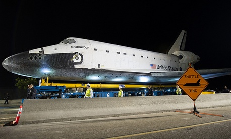 The space shuttle Endeavour is seen atop the Over Land Transporter (OLT) after exiting the Los Angeles International Airport on its way to its new home at the California Science Center in Los Angeles, Friday, Oct. 12, 2012.