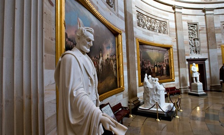 Statues of statesmen mark the interior of the Capitol Rotunda.