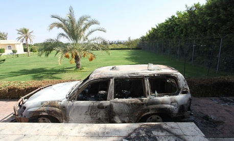A burnt car is parked in front of U.S. consulate in Benghazi after the attack in September.