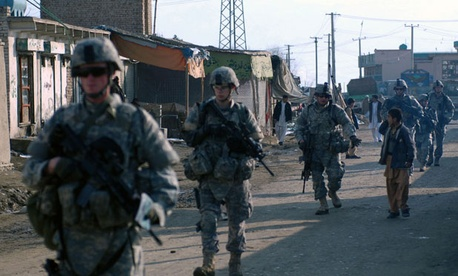 Soldiers conduct foot patrols in Kabul in 2009.