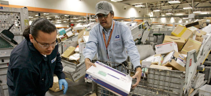 Postal employees sort mail in San Francisco in 2007.