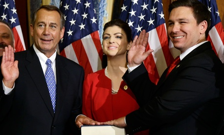 House Speaker John Boehner of Ohio performs a mock swearing in for Rep. Ron DeSantis, R-Fla.