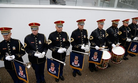 Members of the Army Band stand in front of the Presidential Reviewing Stand in front of the White House during a rehearsal Jan. 13, 2013.