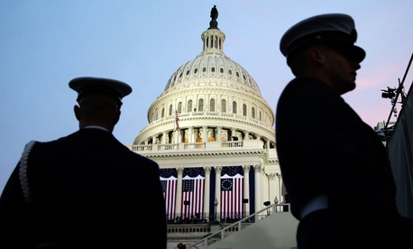 Ceremonial Coast Guard honor guards frame the U.S. Capitol before the ceremonial swearing-in of President Barack Obama during the 57th Presidential Inauguration in Washington.