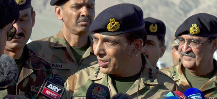 Pakistan's army chief Gen. Ashfaq Parvez Kayani, center, speaks with reporters in 2012.
