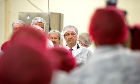 French president François Hollande inspecting a plant belong to Findus, the Swedish company implicated in the horse meat scandal, in March.