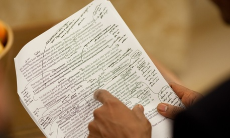 Words, words, words. President Obama reviews a 2009 speech on education.