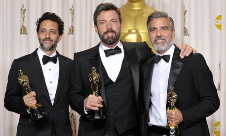 "Grant Heslov, from left, Ben Affleck, and George Clooney pose with their award for best picture for ""Argo"" during the Oscars."