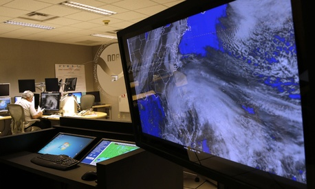 A satellite image of Hurricane Sandy is shown on a computer screen at the National Hurricane Center in Miami.