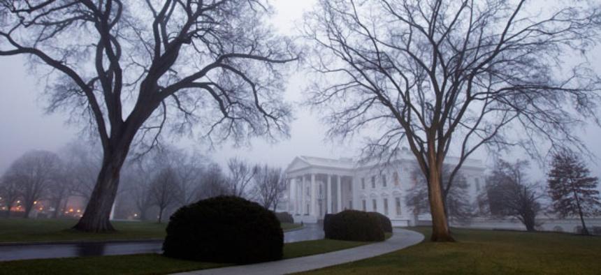 Fog envelopes the White House in December.
