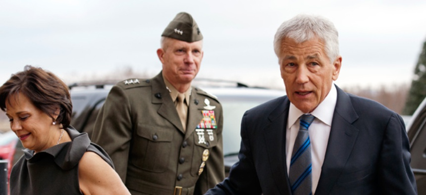 Former Sen. Chuck Hagel, R-Neb., right, and his wife Lilibet, as they arrive at the Pentagon to be sworn-in as Secretary of Defense.