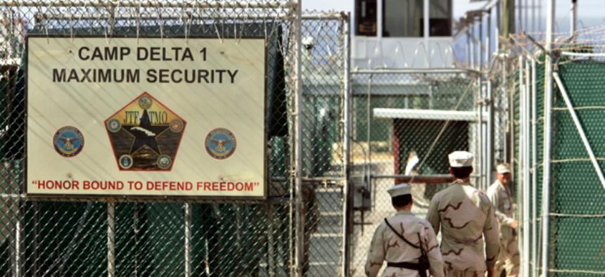 US military guards walk within Camp Delta military-run prison, at the Guantanamo Bay US Naval Base.