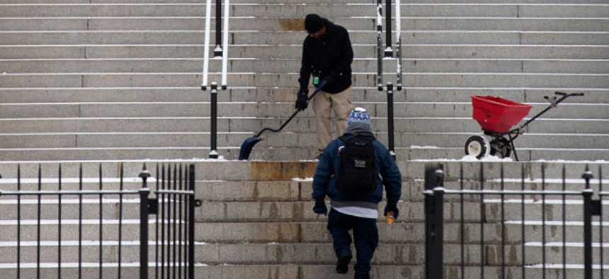 Workers shoveled the Eisenhower Executive Office Building after a snow in January.