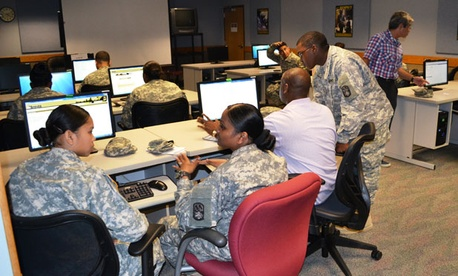 Soldiers on Okinawa, Japan, register for college courses at Torii Station's Education Center in early March.