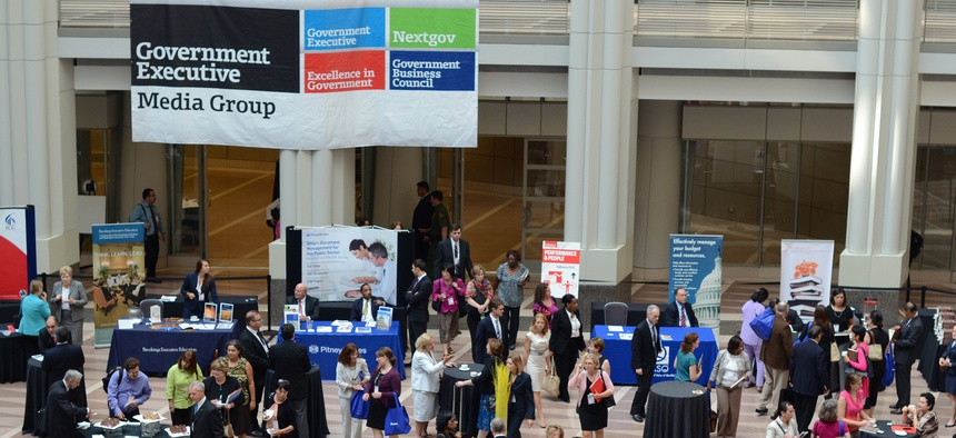 Attendees confer at Excellence in Government 2012.