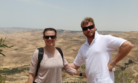 Carissa Pastuch and Charles Mink, who married after serving in Iraq, stand in front of Mount Nebo in Jordan in June 2012. They met during interrogation school in Arizona and worked at the same base in Iraq during the war.
