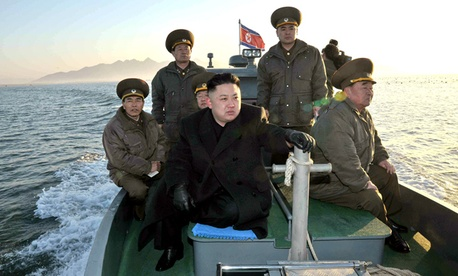 North Korean leader Kim Jong Un rides on a boat.