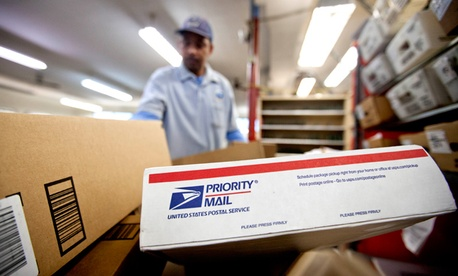 Packages wait to be sorted in a Post Office