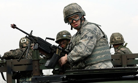 U.S. Air Force Airman First Class, Lee Simpson mans a machine gun atop a humvee, with South Korean soldiers during a joint military drill between South Korea and the United States near Seoul.