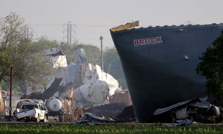 Mangled debris of a fertilizer plant are seen Thursday, April 18, 2013, a day after an explosion leveled the plant in West, Texas.