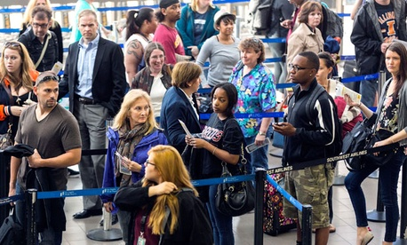Travelers stand in a long line at Los Angeles International Airport Monday.