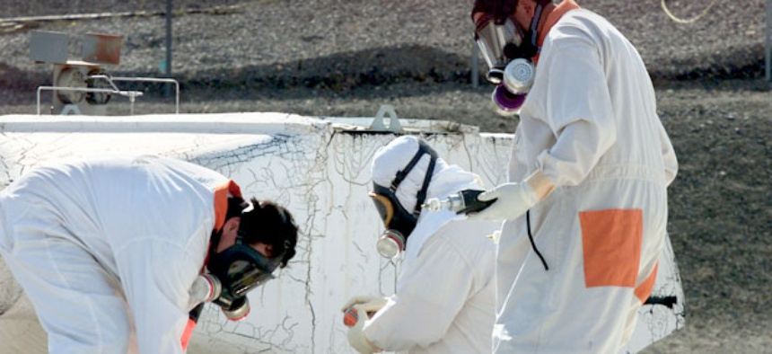 Workers measure for radiation and toxic vapors at the Hanford Nuclear Reservation near Richland, Washington.