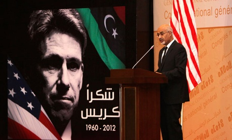 Libyan President Mohammed el-Megarif spoke at the memorial service in Tripoli, Libya, Thursday, Sept. 20, 2012, for U.S. Ambassador to Libya, Chris Stevens.