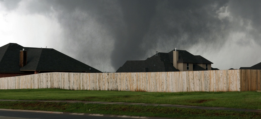 A tornado moves through Moore, Oklahoma.