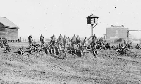 African American soldiers resting in Virginia in 1864 near Aiken's Landing, Va.