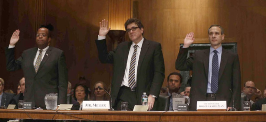 TIGTA J. Russell George, former Acting IRS Commissioner Steven Miller, and former IRS Commissioner Douglas Shulman give oaths before testifying in front of the Senate Finance Committee