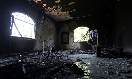A Libyan man investigates the inside of the U.S. Consulate in Benghazi after the attack in September.
