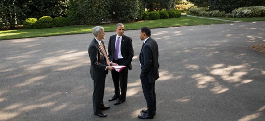 Barack Obama, Rob Nabors  and  Denis McDonough confer outside the White House.