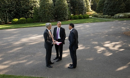 Barack Obama, Rob Nabors  and  Denis McDonough confer outside the White House.