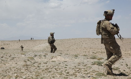 Soldiers conduct a patrol in Ghazni province in 2012.