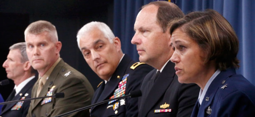 Air Force Brig. Gen. Gina M. Grosso, right, speaks during a news conference at the Pentagon, Tuesday, June 18, 2013, to discuss women in combat.