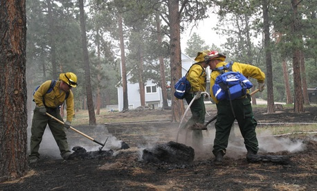 Soldiers from the 1157th Engineer Firefighter Company, Colorado National Guard, smother hot spots near Colorado Springs.