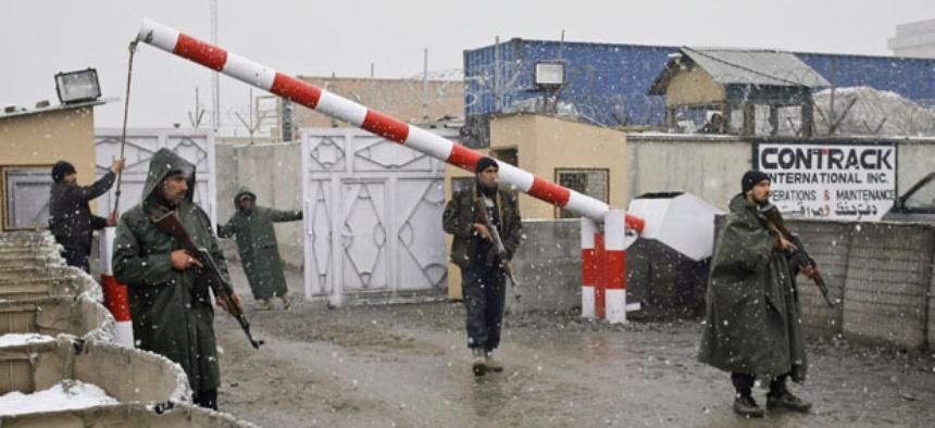 Afghan contractors work in Kabul in December.