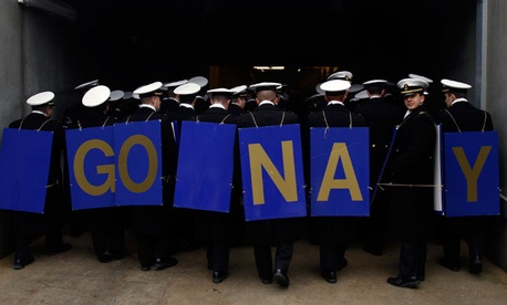 Navy Midshipmen march off the field before the start of the Army-Navy football game in December.