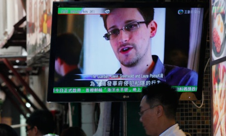 A television shows an interview with Edward Snowden in Hong Kong.