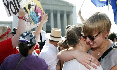 American University students Sharon Burk, left, and Molly Wagner, embrace outside the Supreme Court in Washington.