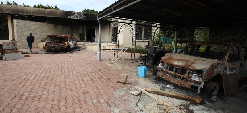 Charred vehicles occupy the remains of the U.S. Consulate in Benghazi in September.