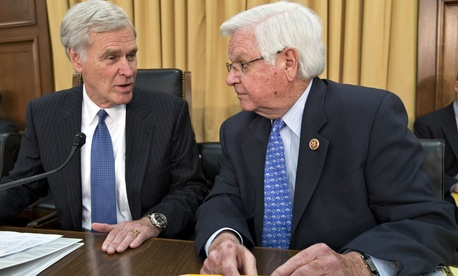 House Appropriations Committee Chairman Rep. Hal Rogers, R-Ky., right, talks with House Financial Services and General Government subcommittee Chairman Rep. Ander Crenshaw, R-Fla. during a hearing investigating the IRS.
