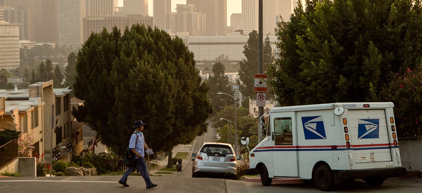 A 25-year veteran U.S. mail carrier walks his route in Los Angeles.