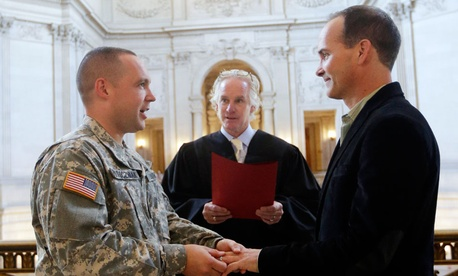 Army Capt. Michael Potoczniak, left, and Todd Saunders are married at City Hall in San Francisco.